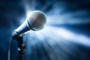 bigstock-microphone-on-stage-26918468